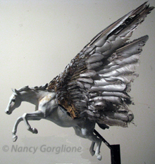 Pegasus Model in bees wax, feathers, paint and metal armature by nancy Gorglione